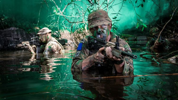 Soldiers conducts a river crossing during a patrol