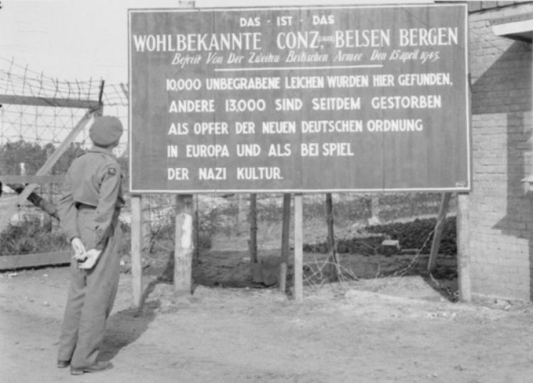 British soldier looks at sign of Bergen-Belsen 1945 CREDIT ROYAL NAVY.jpg