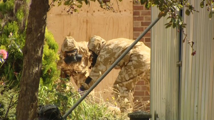 British soldiers work to decontaminate Mr Skripal's house.