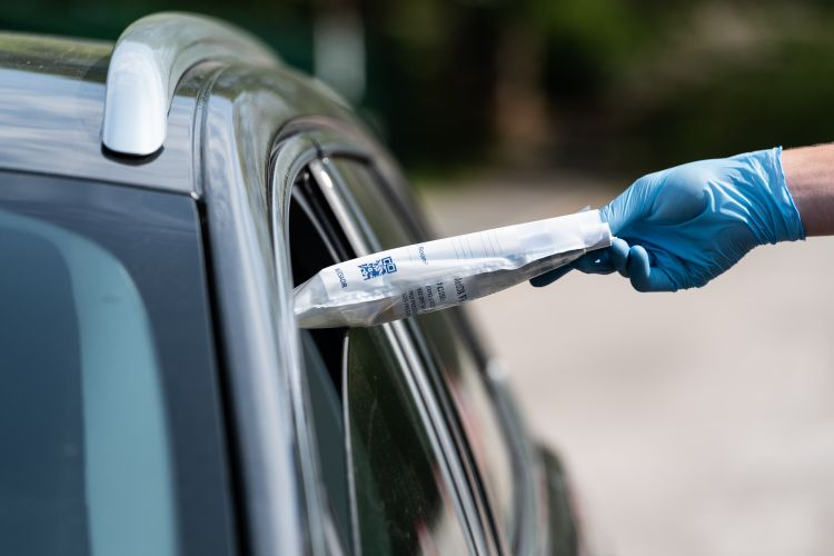 COVID19 Coronavirus test kit is posted through the car window at the Mobile Testing Unit in Kendal 250420 CREDIT MOD