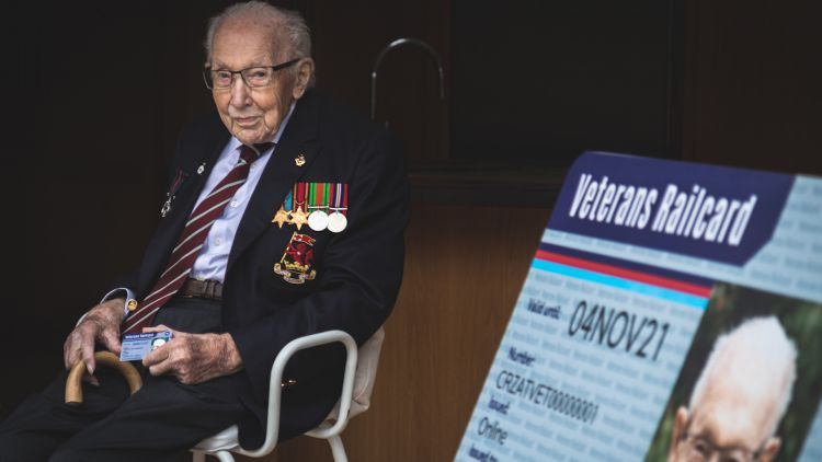Captain Sir Tom Moore sits holding first ever veterans Railcard 131020 CREDIT Department of Transport.jpg