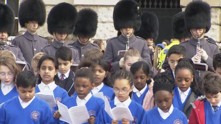 Children and guards at Commonwealth Day celebrations 110319 CREDIT BFBS