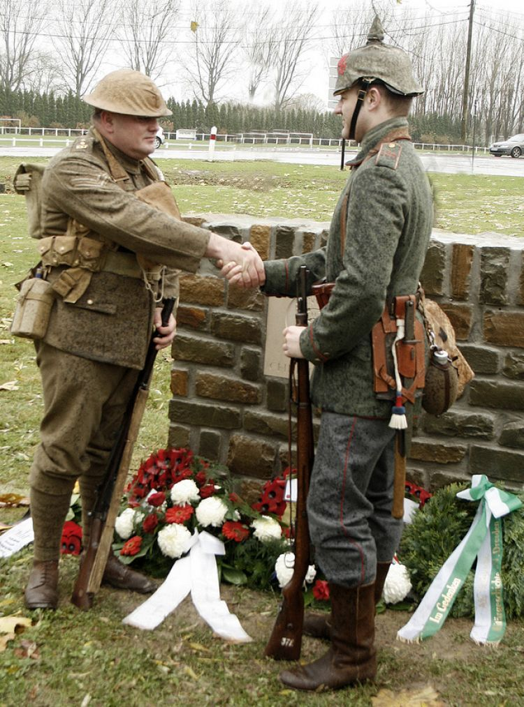 Descendants of Great War veterans shake hands at the unveiling a Christmas Truce memorial (Picture: Alan Cleaver).
