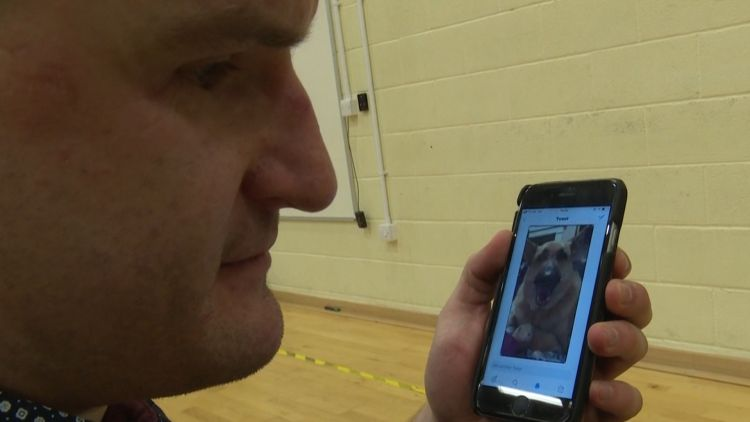 Blind veteran Rob Long listens to Twitter visual aid
