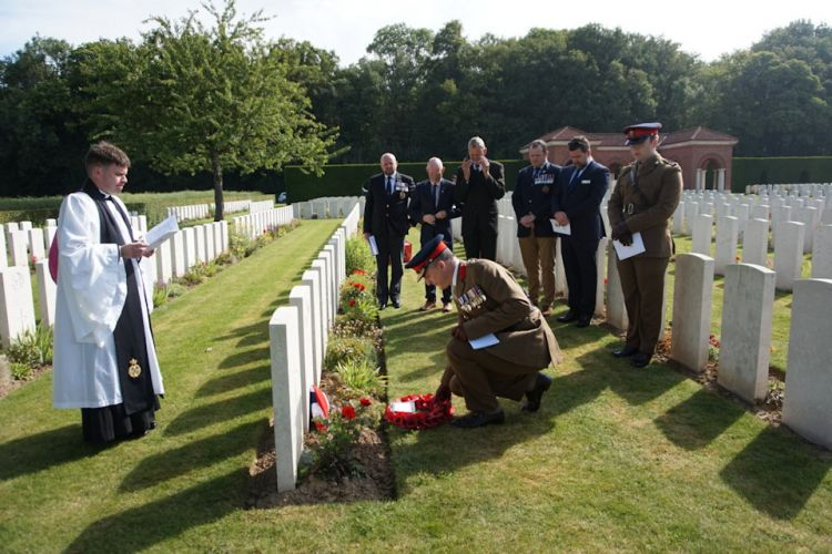 Col Martin David MC, representing the British Embassy in Paris, lays a wreath at the graveside of Cpl Davies 190619 CREDIT Crown Copyright.JPG
