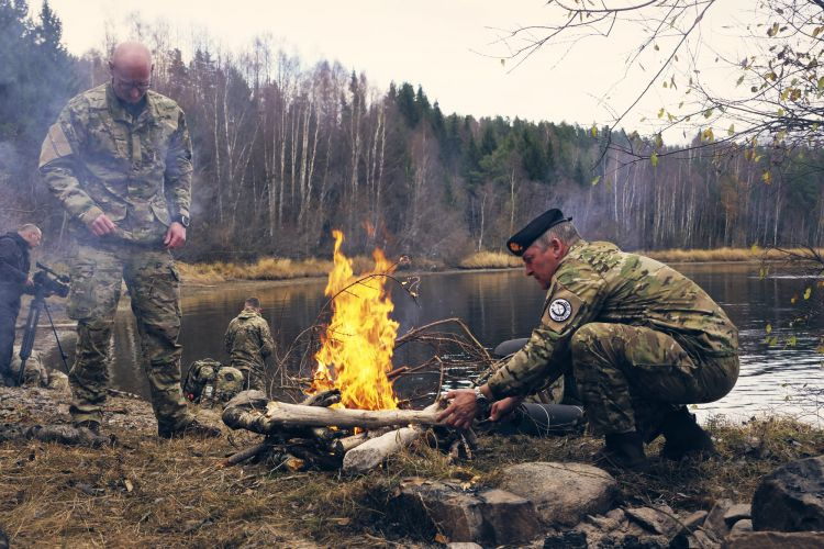 A fire being built next to the Trident Juncture cold water training
