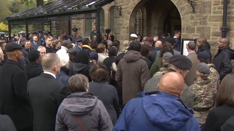 Crowds outside the church for Oswald Dixons funeral 091019 CREDIT BFBS.jpg