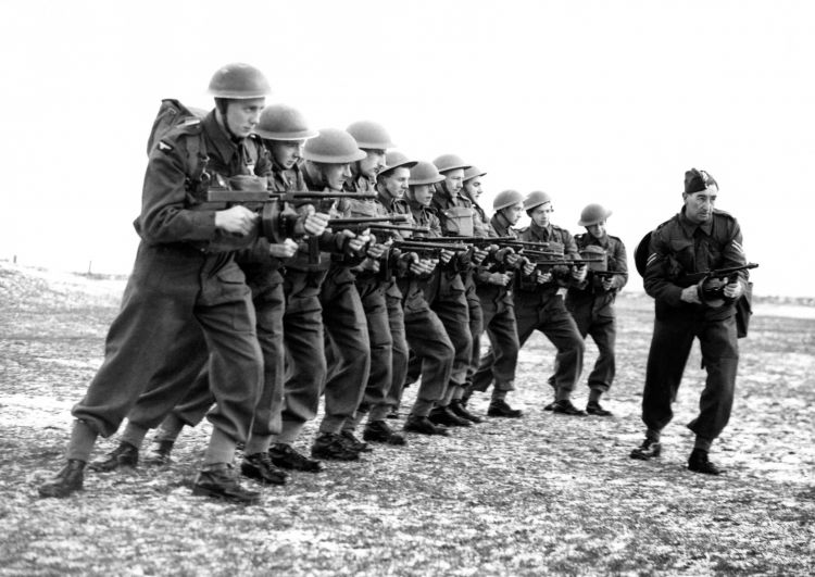An Army instructor teaching men of the newly-formed RAF Aerodrome Defence Corps on the Thompson sub-machine gun