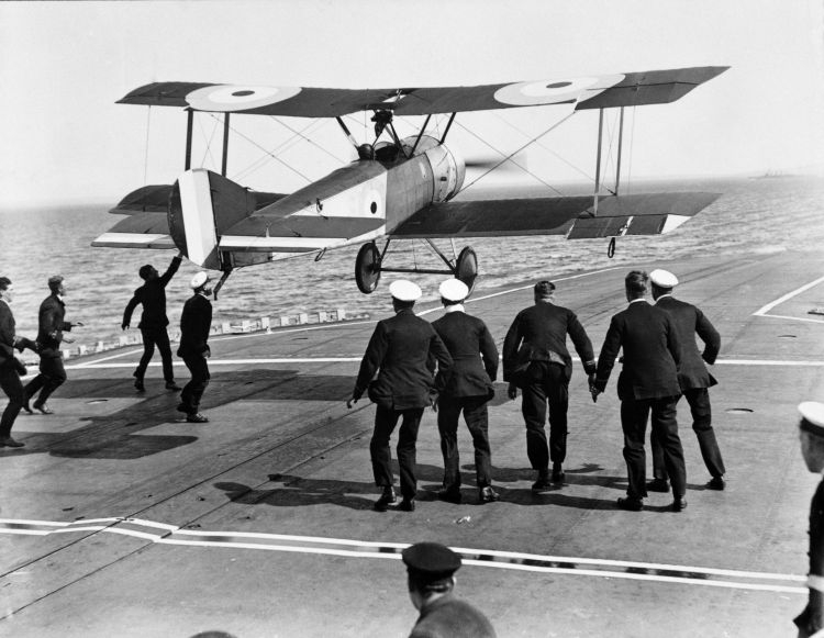 Crown Copyright - Squadron Commander EH Dunning attempting to land his Sopwith Pup (N6453) on the flight deck of HMS Furious