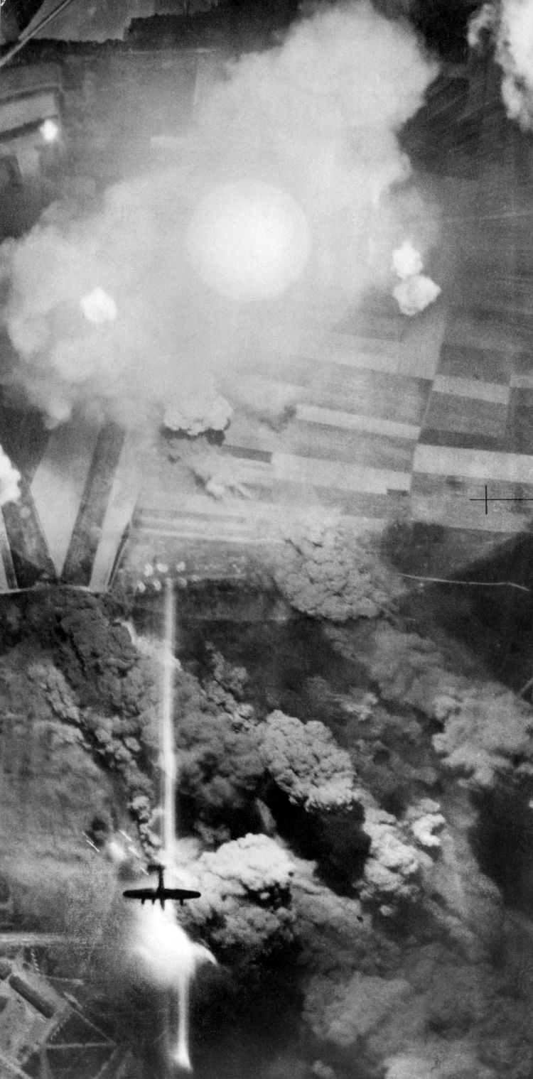 vertical photograph taken during the night attack on the German tank and vehicle depot at Mailly-le-Camp, France, on 34 May 1944 by 346 Lancaster's and Halifax's of Nos 1 and 5 Groups, Bomber Command