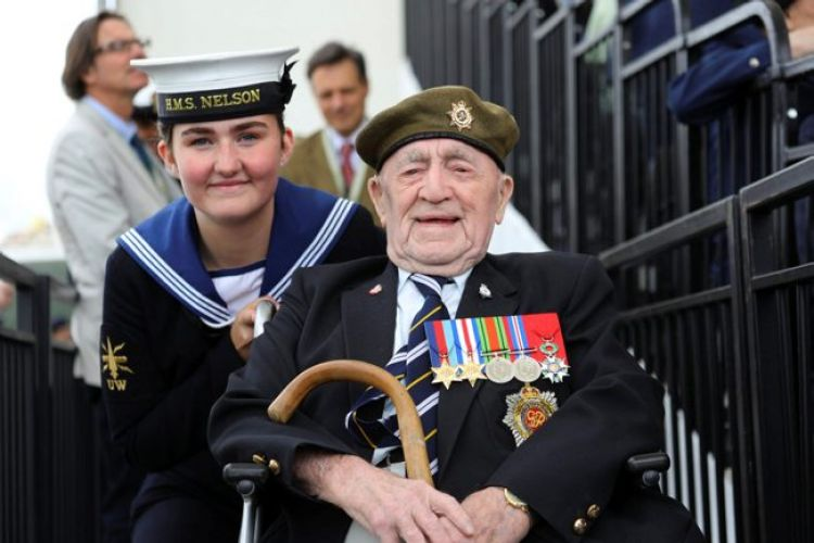 D Day veteran Henry Cullen, seen here with Bethany Thomson of HMS Nelson, at an international D-Day event on Southsea Common 050619 CREDIT MOD.jpg
