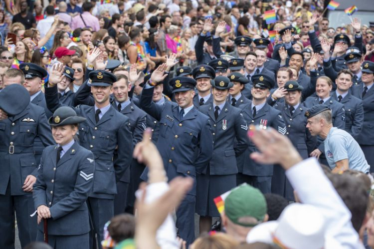 RAF personnel are seen here waving to the crowds, as they take part in the Pride in London Parade.