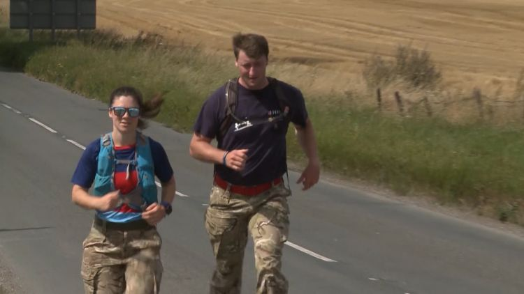 Darren Hardy running during first of two gruelling charity challenges with his running partner 240820 CREDIT BFBS