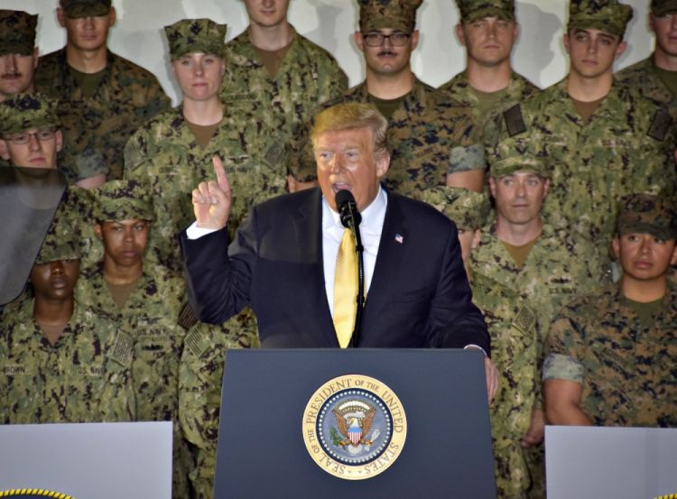 Donald Trump on board USS Wasp in Japan with troops behind