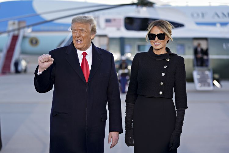 Donald Trump pumps fist with Melania Trump beside him as they arrive at Joint Base Andrews, Maryland, for farewell ceremony 200121 CREDIT PA