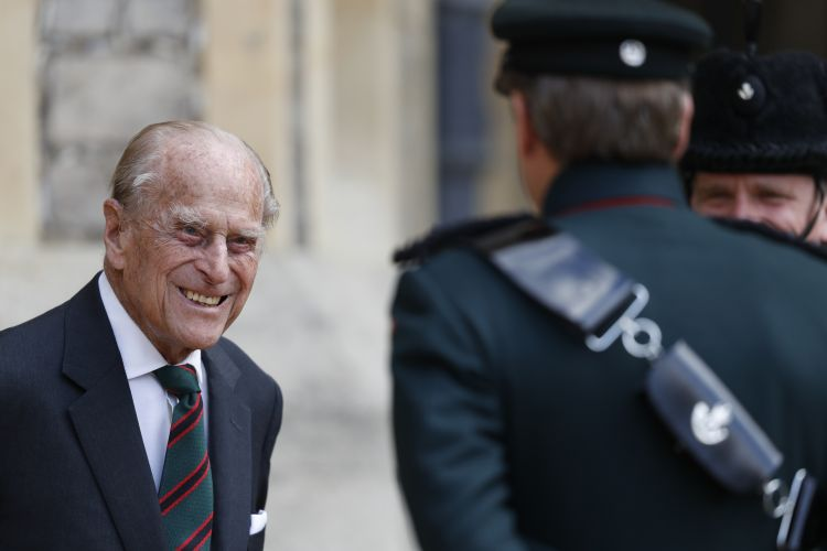 Duke of Edinburgh speaks to a bugler at Windsor Castle during a ceremony for the transfer of the Colonel-in-Chief of the Rifles from the Duke to the Duchess of Cornwall 220720 CREDIT PA