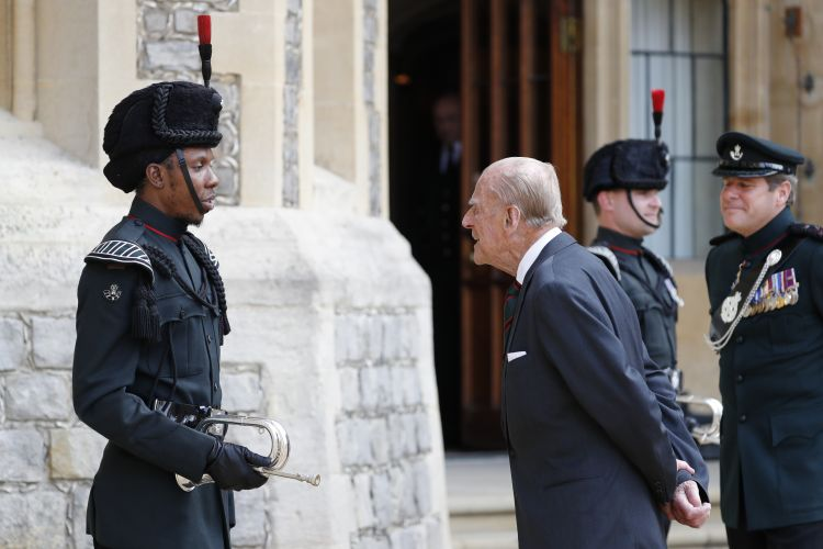 Duke of Edinburgh speaks to a bugler outside Windsor Castle during a ceremony for the transfer of the Colonel-in-Chief of the Rifles from the Duke to the Duchess of Cornwall 220220 CREDIT PA