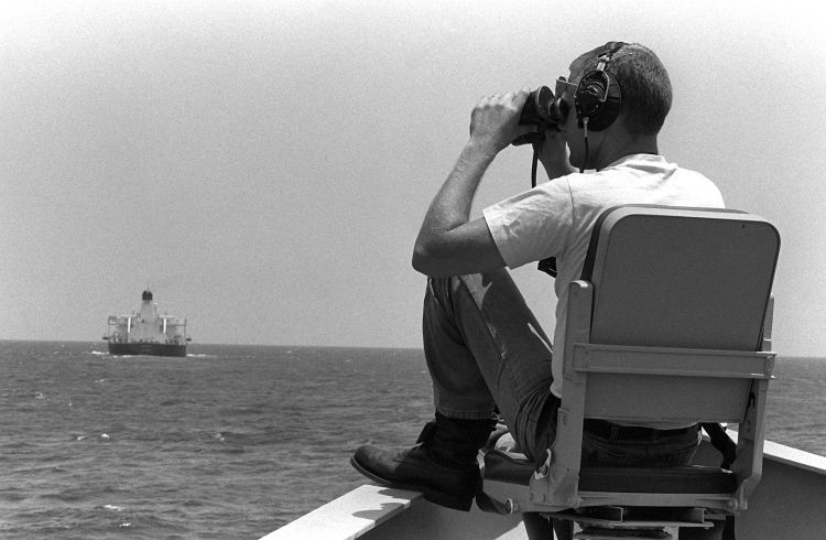A US sailor on lookout for mines during a convoy support mission. (Image: US Navy)