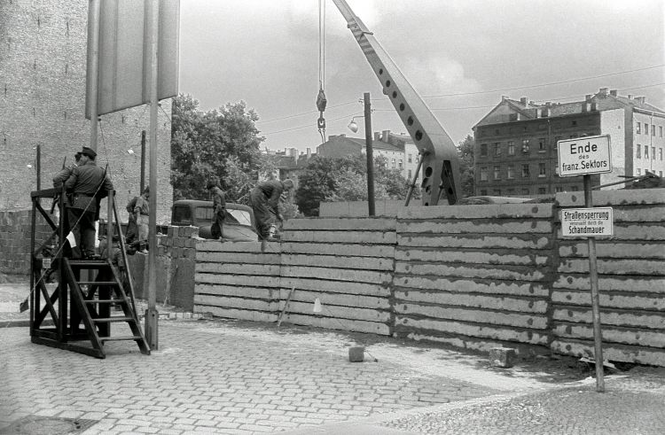 East German workers constructing the Berlin Wall