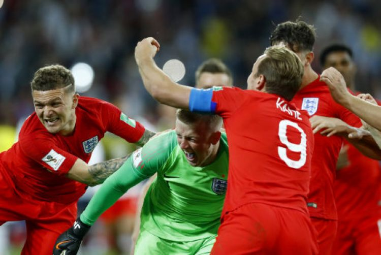 England players jubilant after their first ever World Cup penalty shootout win (Picture: PA).