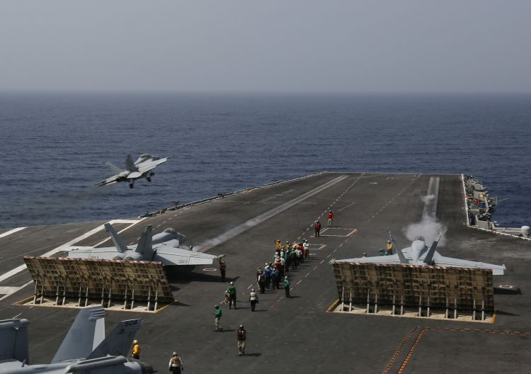 FA-18E Super Hornets take off Nimitz-class aircraft carrier USS Abraham Lincoln