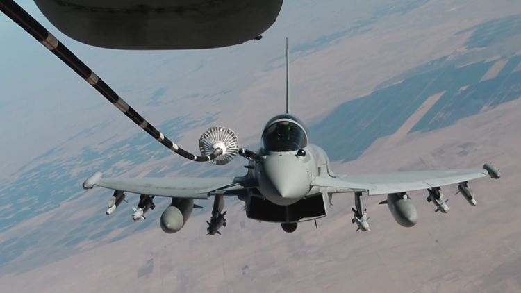 A British Typhoon takes on fuel from a US Air Force tanker