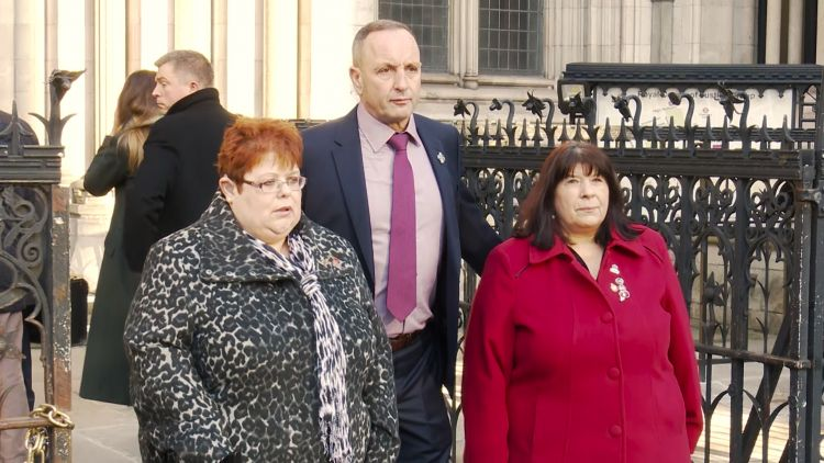 Families bringing case against John Downey outside High Court 111219 CREDIT BFBS