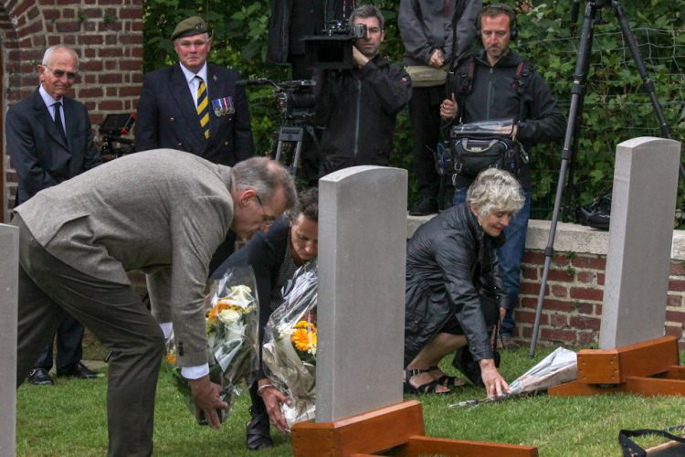 Families lay flowers at burial service for WWI soldiers in France