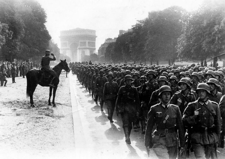 German troops march in a victory parade near Arc de Triomphe after taking control over Paris 14061940 CREDIT PA.jpg