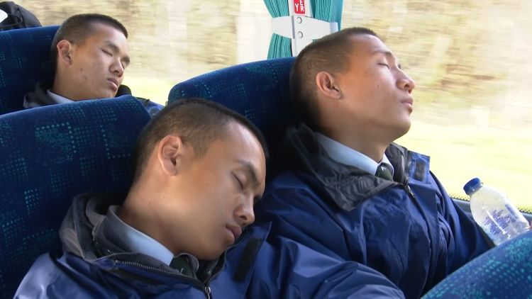 Gurkhas sleep on the bus to Catterick 120219 CREDIT BFBS