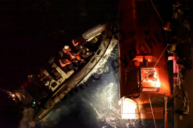 HMS Argyll's seaboat  'nudged'  the ship's lifeboat to help sailors escape (Picture: Royal Navy).