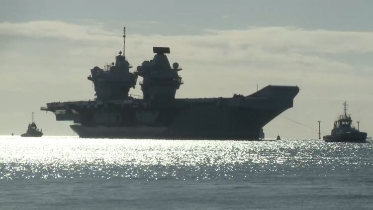 HMS Queen Elizabeth returns to Portsmouth with tugs 151020 CREDIT BFBS