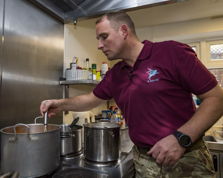 WO1 Olly Rogers at the stove