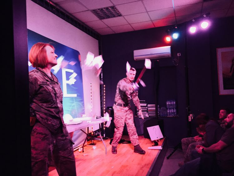 Magician Richard Jones wows the audience with his sword trick in Afghanistan