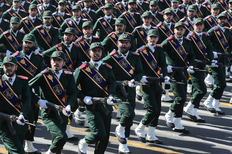 Iranian military soldiers marching during annual parade marking 1980-1988 war with Iraq