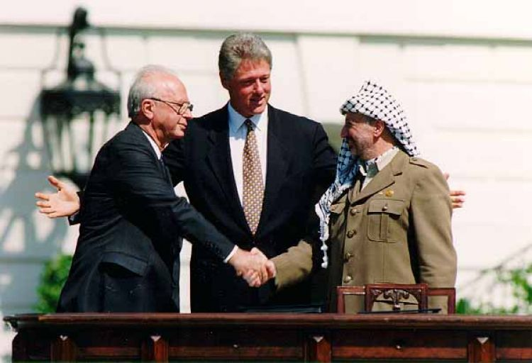 President Bill Clinton with Israeli Prime Minister Yitzhak Rabin (left) and chairman of the PLO (Palestinian Liberation Organization) Yassir Arafat in 1993