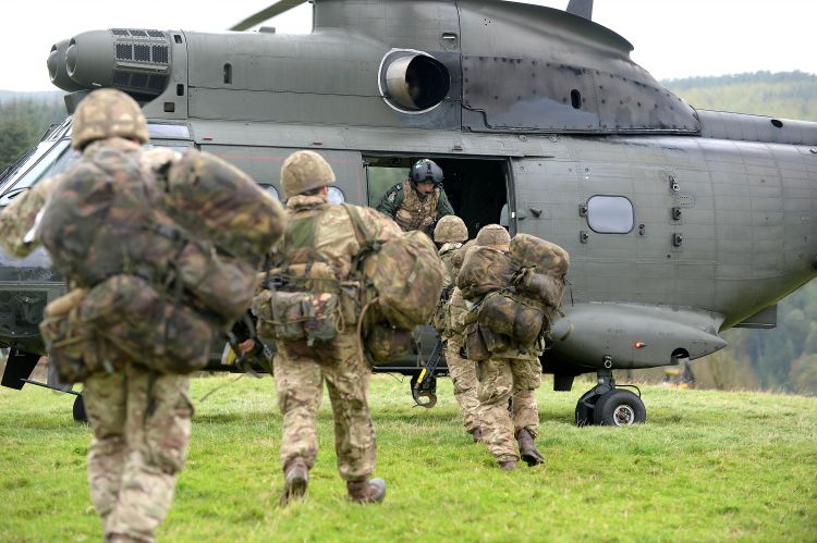 Troops board a Puma helicopter during a previous Cambrian Patrol. Credit: Crown Copyright