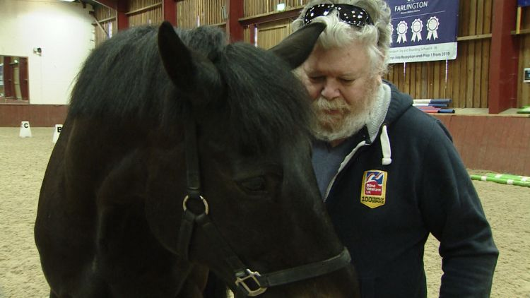 Jeffrey Stockwell at the Merrist Wood College with a horse 250319 CREDIT BFBS.jpg