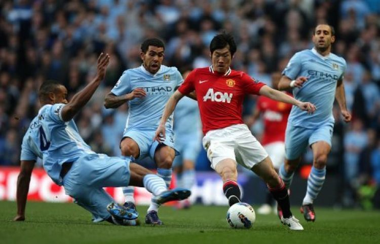 Ji-Sung Park against Manchester City in 2012 (Picture: PA).