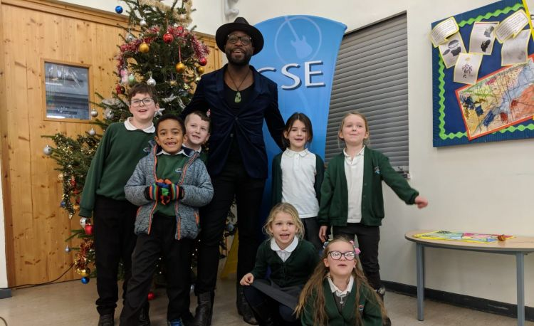 Kevin Davy White with children at Attenborough School, Germany
