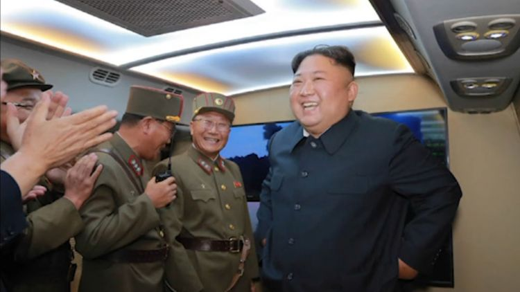 Kim Jong Un laughs after NK missile launches 070819 CREDIT KCNA.jpg