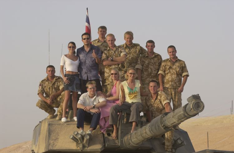 Steps on a tank in Oman ahead of CSE show in 2001