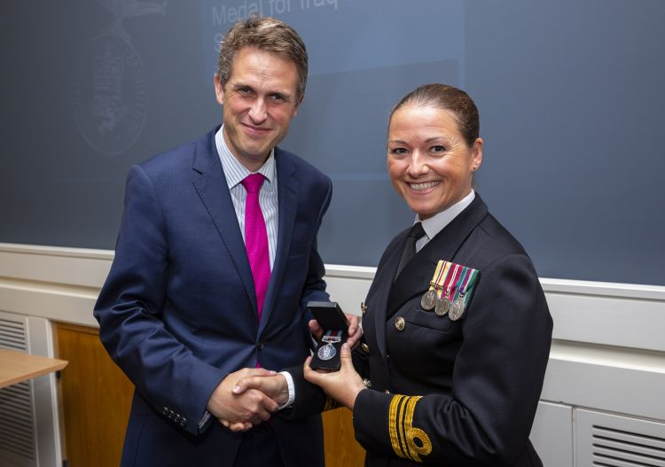 Lt Cdr Lindsey Waudby (right) with the Secretary of State for Defence, Gavin Williamson (left) after being presented with her new Operational Service Medal at a ceremony at the Ministry of Defence building in London today