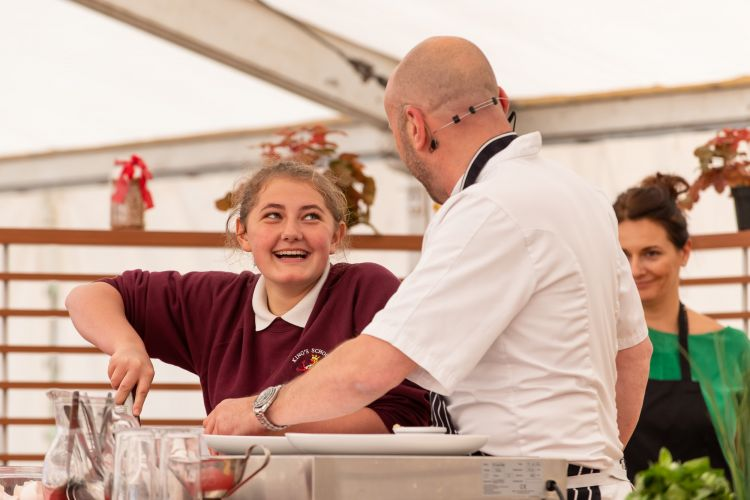 Ffion joined Simon on stage to help make pancakes (photo credit Mr Mike Wilkinson)