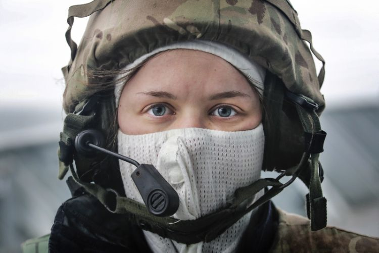a female sailor onboard HMS Albion, taking part in a simulated attack exercise.