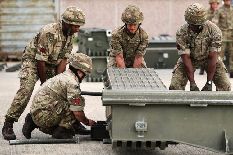 Members of 131 Commando Squadron setting up an Air Portable Ferry Bridge 150516 CREDIT MOD