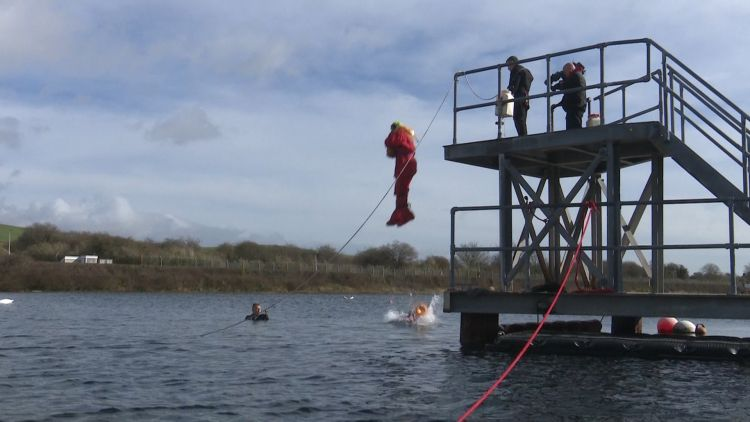 Mike Scholes about to jump in water during training 050319 CREDIT BFBS