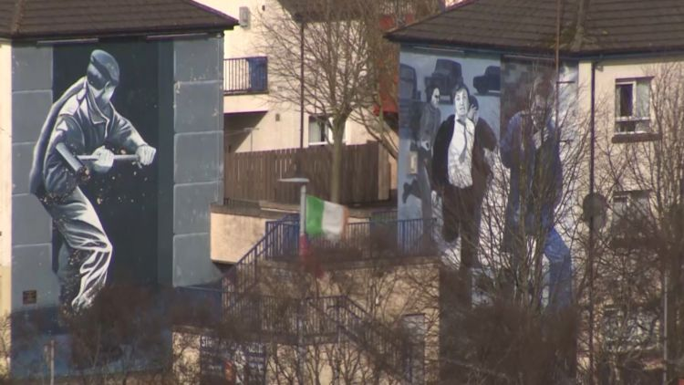 Murals commemorating The Troubles on the side of houses in Londonderry