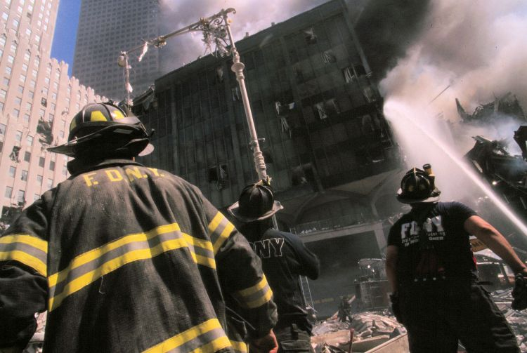 New York firefighters burning building September 11