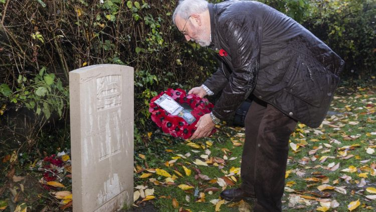 Ernest Calpin's Grandson Michael pays tribute at his headstone in York 081118 Credit SWNS
